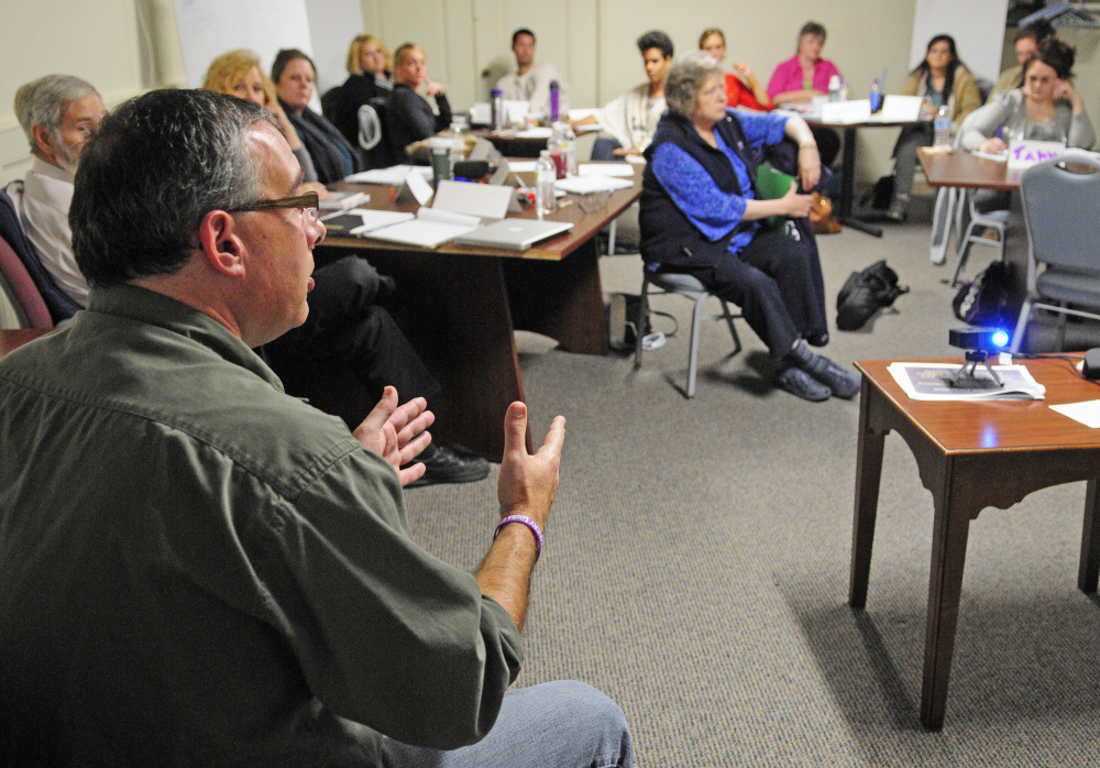 "Darren Ripley, of the Maine Alliance for Addiction Recovery, talks during training for people volunteering as ""angels"" on Friday  at the Olde Federal Building in Augusta."