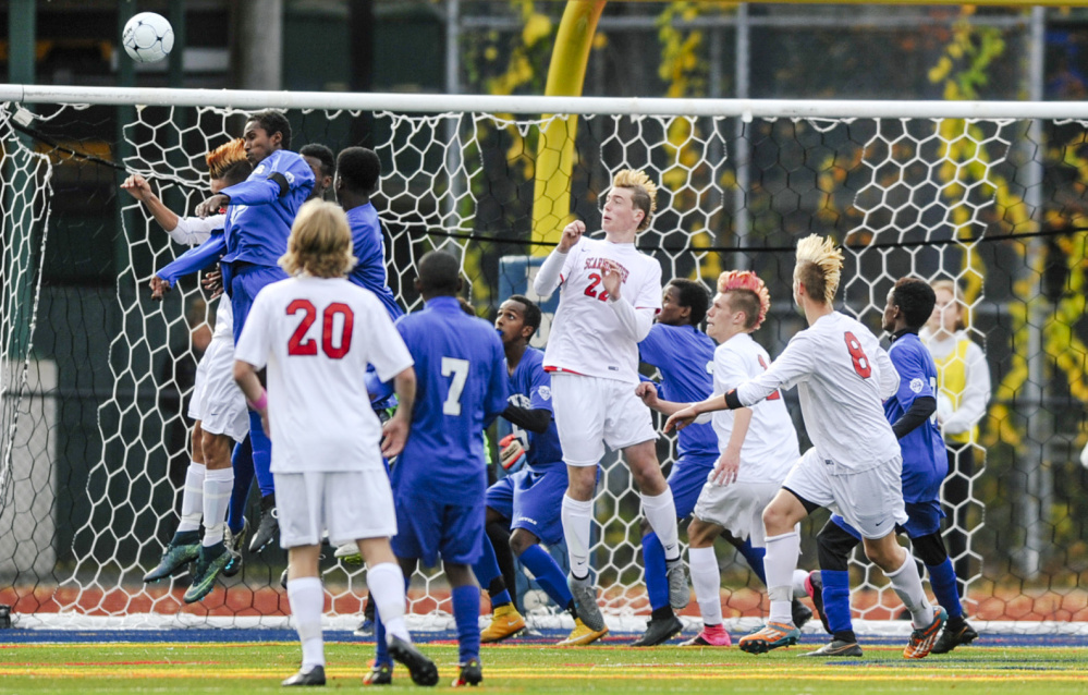 Lewiston players defend their goal – and their perfect season – beating Scarborough 1-0 Saturday at Portland's Fitzpatrick Stadium, C4