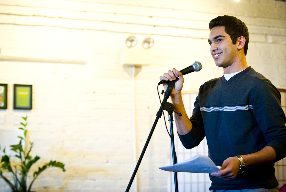 Ibrahim Shkara reads a story to a crowd of over 80 community members, including mentors, at the Telling Room in Portland in June. Photo by Winky Lewis