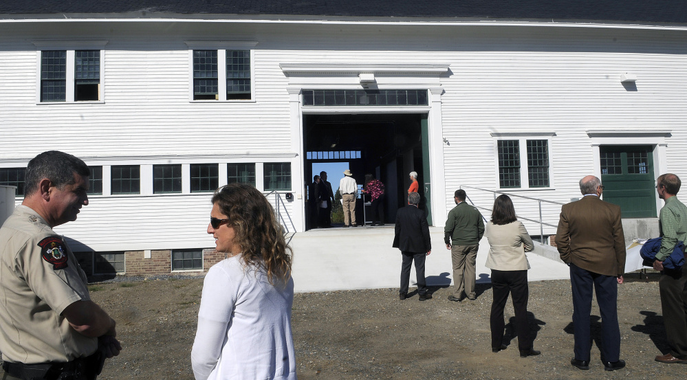 State officials gather in September outside the Campbell Barn in Augusta during a dedication ceremony for the renovated structure at the state complex on the east side of Augusta. The project was honored by Maine Preservation last week, one of 16 in the state recognized by the organization.