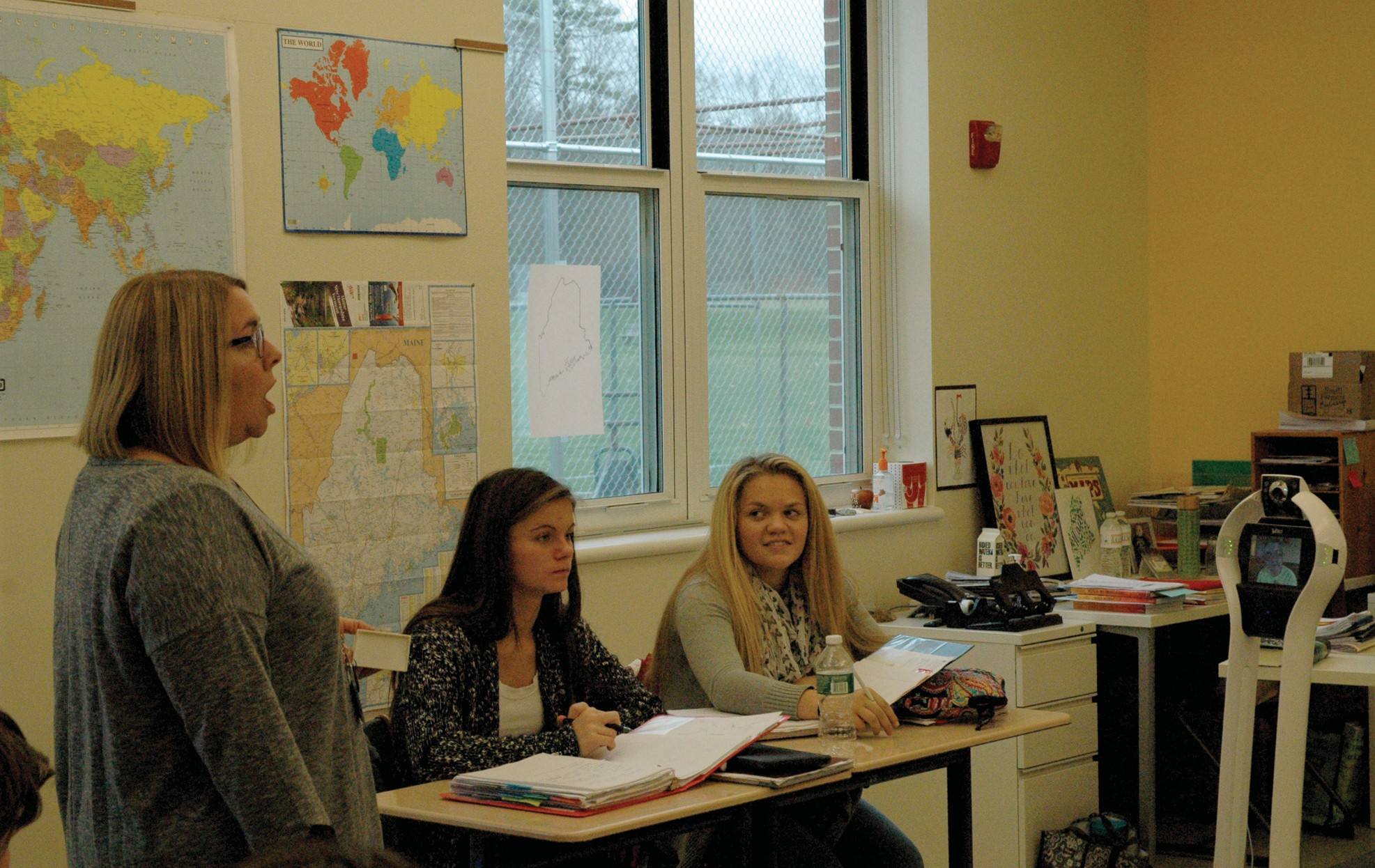 Hayley Desjardins listens remotely from home as Thornton Academy Middle School English teacher Heidi Brewer talks Thursday. Sitting next to Brewer are students Fayth Nedeau and Olivia Paradis.