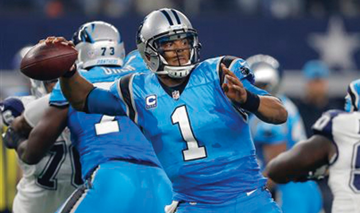 In this file photo, Carolina Panthers quarterback Cam Newton (1) throws a pass in the first half in Arlington, Texas. Clinchings may be at hand in Week 14 of the schedule. Unbeaten Carolina already owns the NFC South title and can secure a first-round playoff bye by beating Atlanta.