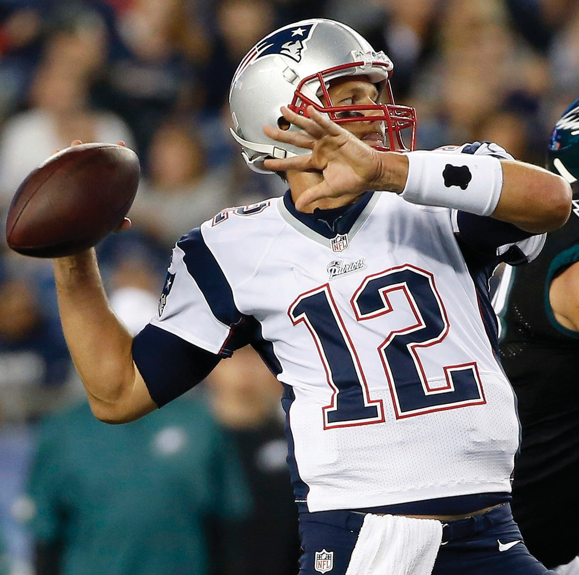 In this Aug. 15, 2014, file photo, New England Patriots quarterback Tom Brady (12) throws a pass against the Philadelphia Eagles during the first quarter of a preseason NFL football game in Foxborough, Mass.
