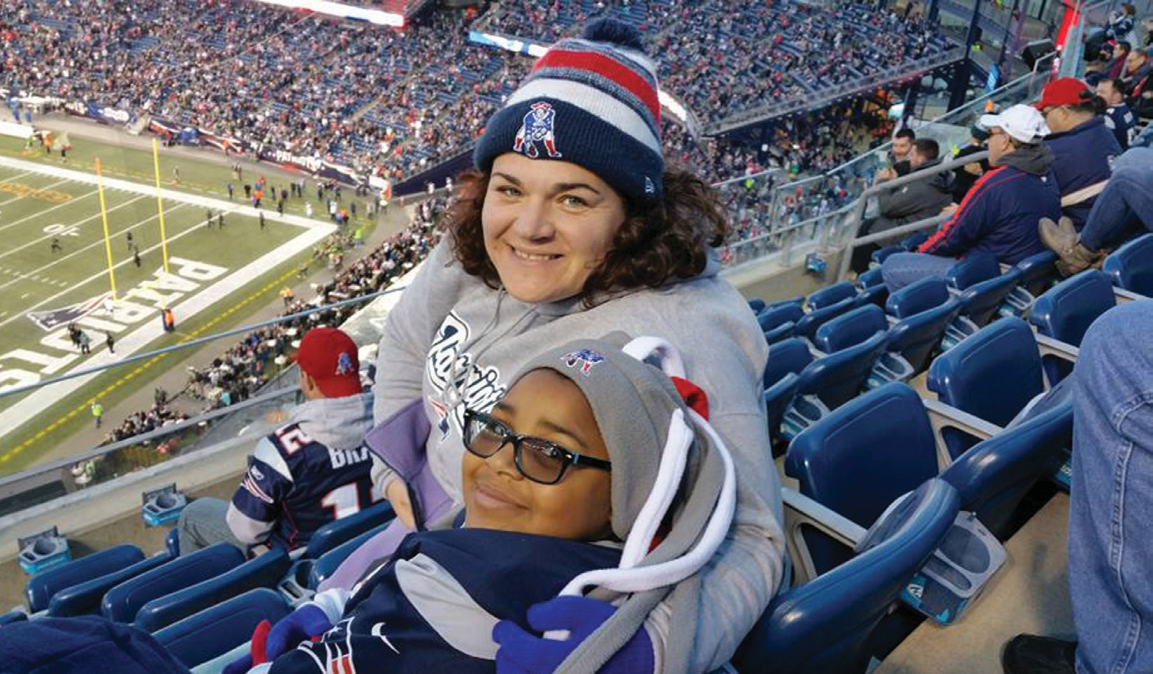 SUBMITTED PHOTOKaren Jean-Paul and her daughter Genevieve sit at the stands of Gillette Stadium in Foxborough, Mass. on Sunday.