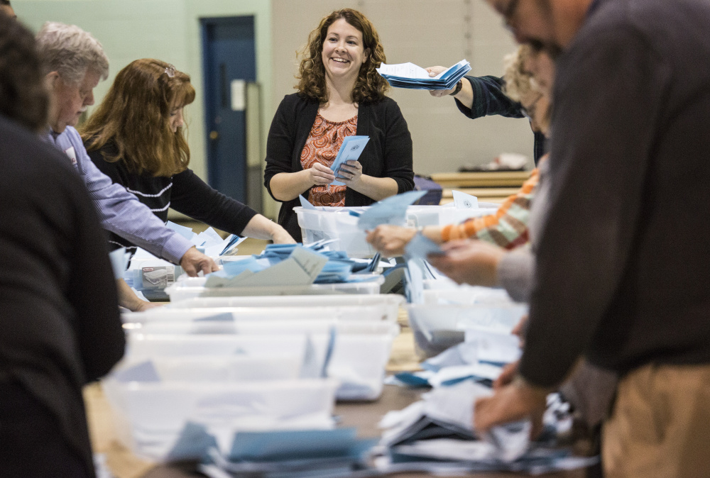Votes are counted for Ben Chin and Robert Macdonald after the polls closed in Lewiston on Tuesday night. Whitney Hayward/Staff Photographer