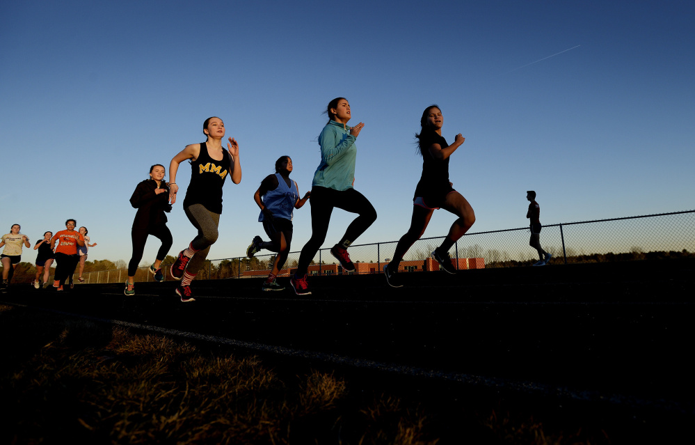 Members of the Greely track team participate in practice on Monday. (Shawn Patrick Ouellette/Staff Photographer)