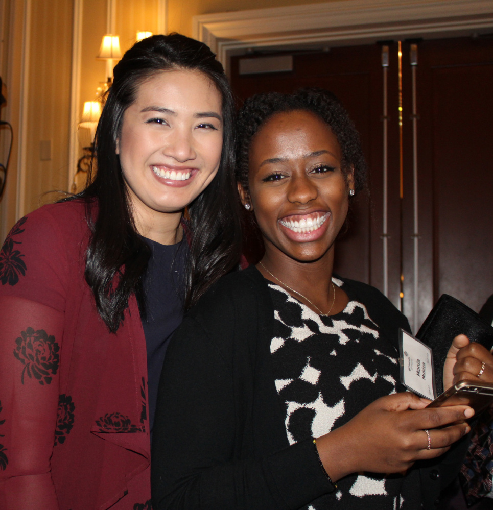 Girl Scouts alums Krylyling Oum, left, and Monia Mukiza.