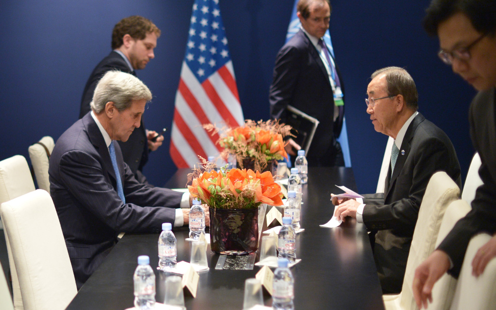 US Secretary of State John Kerry, left, and United Nations Secretary General Ban Ki-moon meet on the sidelines  of the COP 21 United Nations conference on climate change, in Le Bourget, on the outskirts of Paris on Friday Dec. 11, 2015.