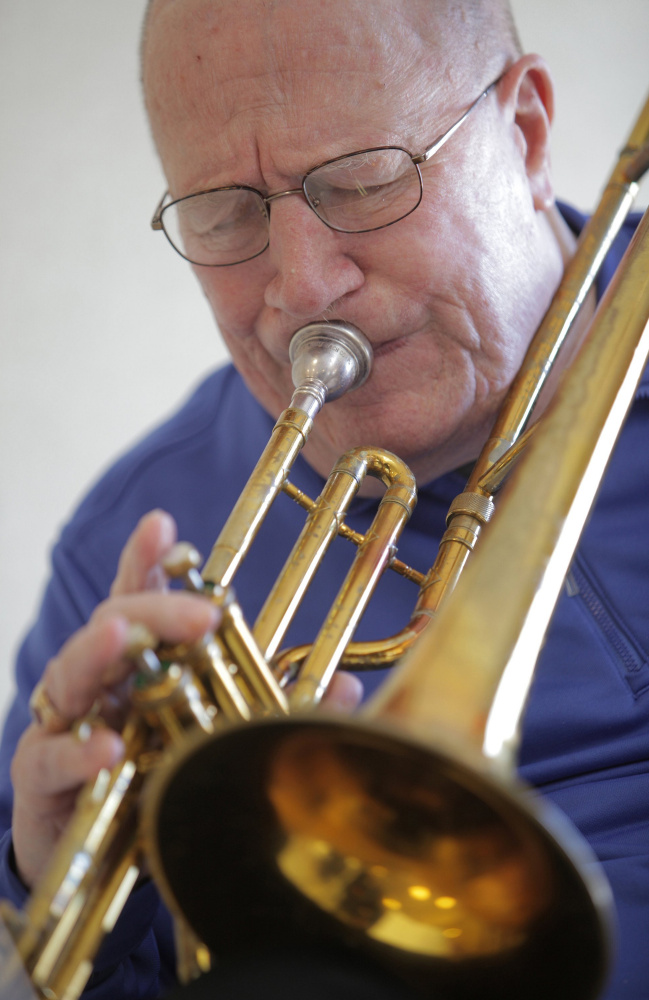 Trombonist Don Doane practices at the Maine Veterans' Home in Scarborough last year. He died Wednesday at 84.