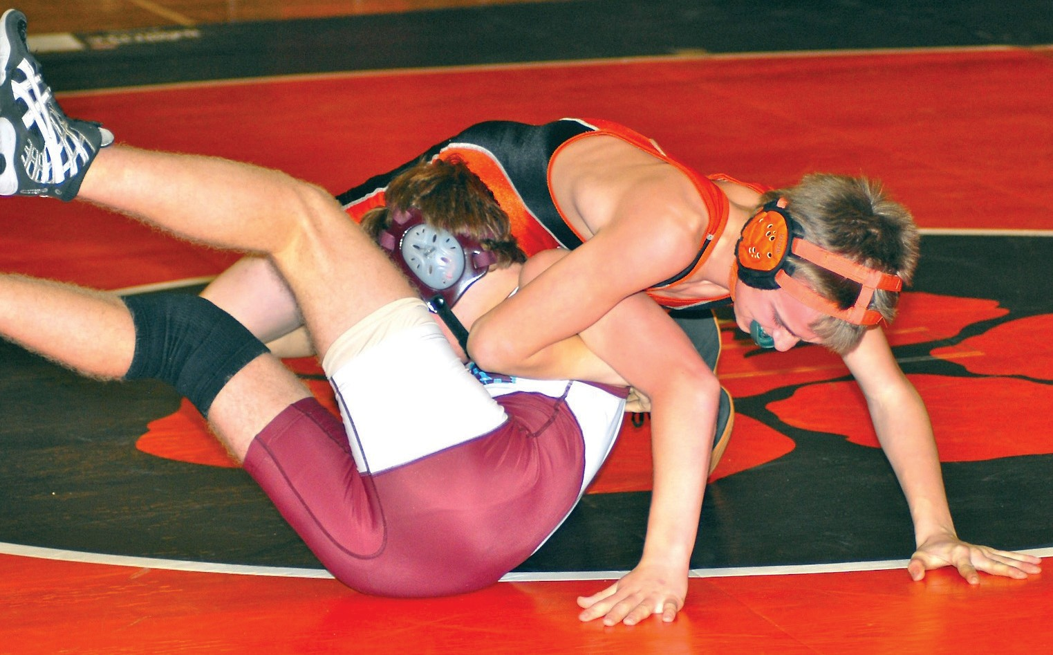 Biddeford's Chris Doner works for a fall during Wednesday's match against Windham.
