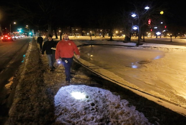 PORTLAND, MAINE - JANUARY 27, 2016: Mike Guthrie, front, and Norman Maze lead a group along the pond in Deering Oaks Park along looking for homeless people during the annual point-in-time homeless count on Wednesday, January 27, 2016. Guthrie works for the City of Portland as a navigator for the Home to Stay program and Maze is the housing director for Shalom House. (Photo by Gregory Rec/Staff Photographer)