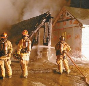 FIREFIGHTERS EXTINGUISH a blaze that destroyed a garage at 287 Hacker Road in Brunswick on Thursday morning and save the nearby house.