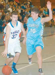 RYAN MELLO dribbles the ball with Oceanside's Mike Norton Jr. (10) defending at Mt. Ararat High School on Tuesday. The Eagles lost the KVAC boys basketball game, 65-55.