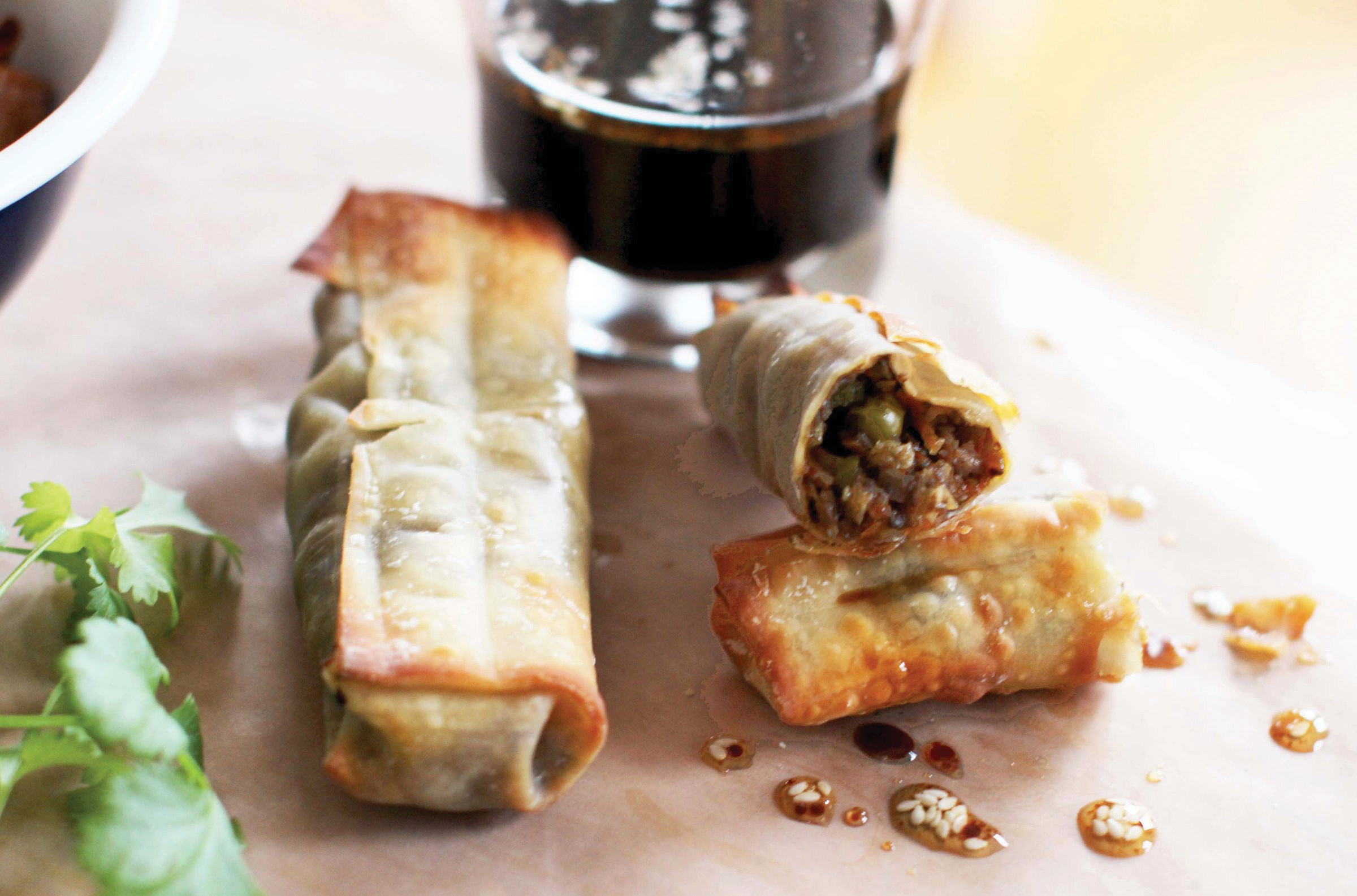 Above photo shows baked egg rolls with sesame-soy dipping sauce.