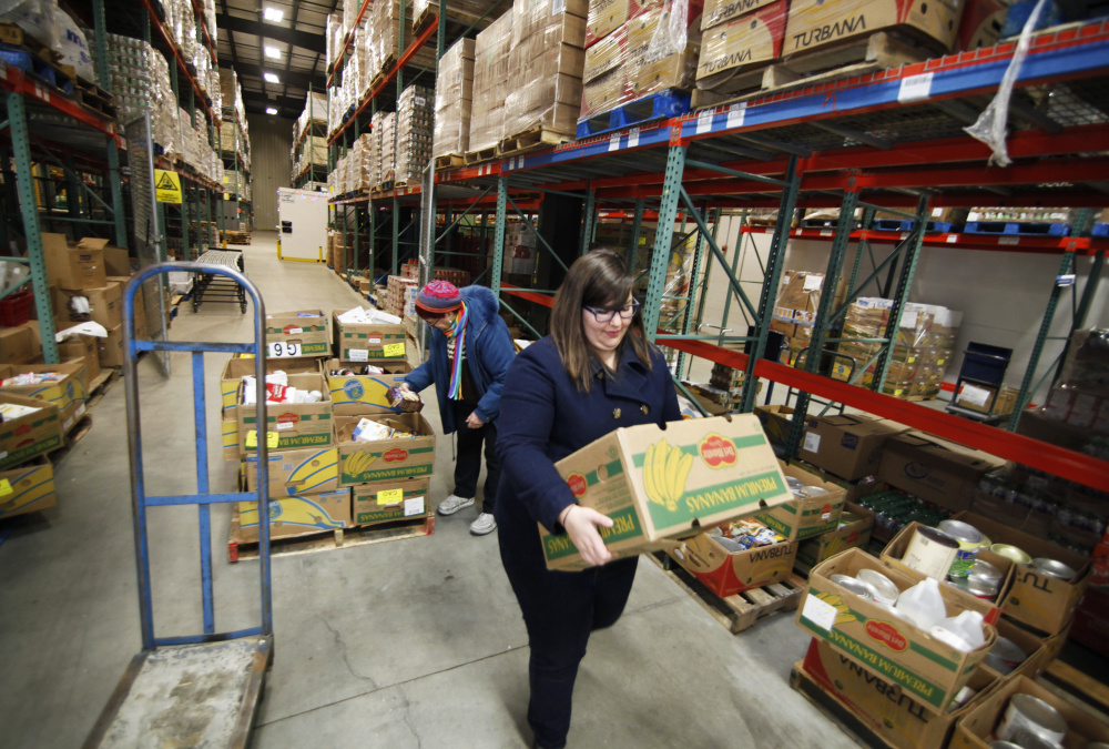 Hunger was nearly eliminated in the U.S. by the 1970s, but it's now so widespread that charitable organizations like the Good Shepherd Food Bank in Auburn, above, have had to develop distribution systems that are as intricate as a grocery chain's.