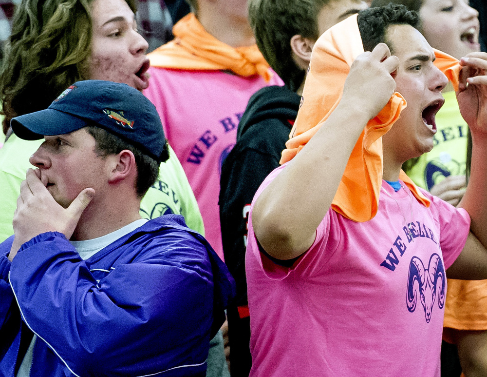 Deering High seniors Connor Ray, 17, left, and Kobe Velez, also 17, react to a first-half foul call against the Rams. A large crowd took in the game between the city rivals at the Portland Expo. Gabe Souza/Staff Photographer