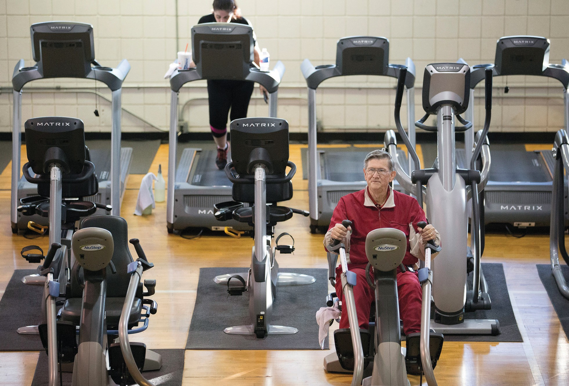 In this photo taken Dec. 22, 2015, Glendon Bassett does a cardio workout at the Family YMCA in Hot Springs, Ark. Bassett, a retired chemical engineer, says he can vouch for the teamwork approach Medicare is promoting.