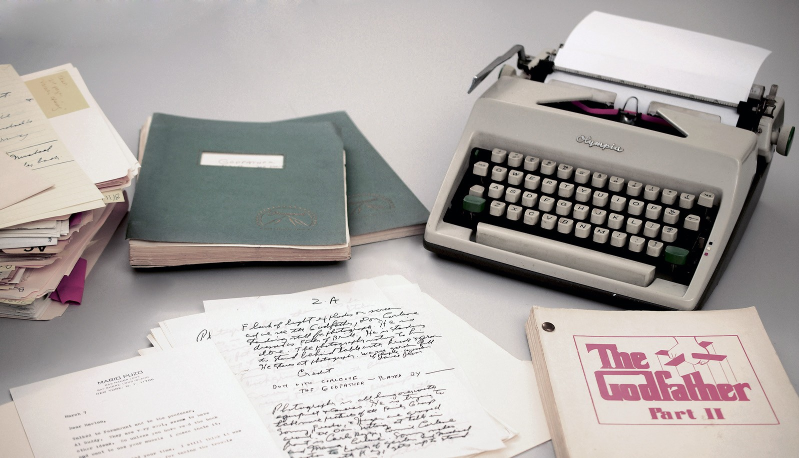 """This 2015 photo from RR Auction shows Mario Puzo's 1965 Olympia typewriter with manuscripts and versions of both """"The Godfather"""" and """"The Godfather Part II"""" screenplays. The items are part of a large collection of Puzo's papers to be auctioned by Boston-based RR Auction on Thursday."""
