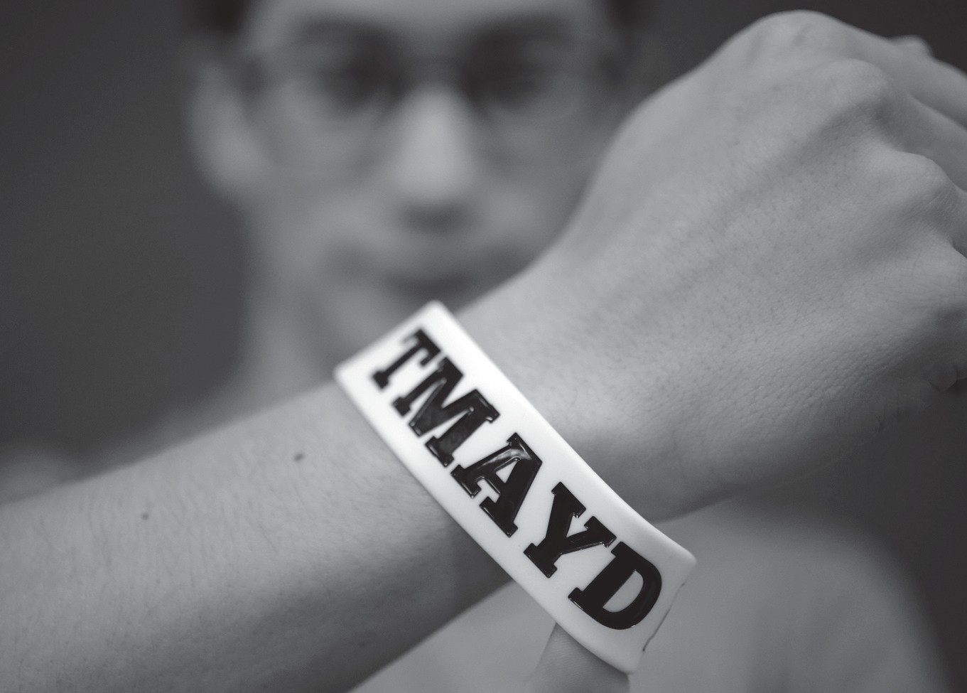 "Massachusetts Institute of Technology student Andy Trattner of Portland, Oregon, displays a wristband that features the acronym TMAYD for ""Tell Me About Your Day,"" a campaign to encourage students to talk to one another in an effort to defuse to the stress of campus life."