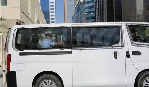 A prison van believed to be carrying some of the four detained American journalists leaves the Public Prosecution offices in Manama, Bahrain, Tuesday.