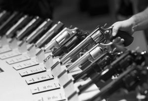 HANDGUNS ON DISPLAY at a trade show on Tuesday in Las Vegas. In Maine, the Legislature may weigh in on the conflict between the rights of private property owners and tenants who want to keep guns in their residences.