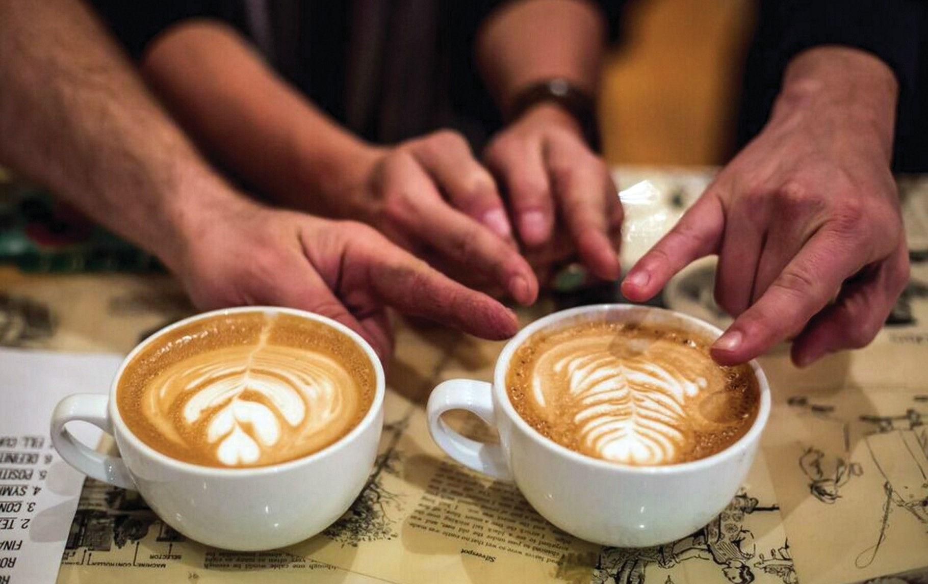 The judges choose Bard Coffee barista Kelsey Sirois' cup as the winner of the Latte Art Throwdown at Elements in Biddeford Thursday night.