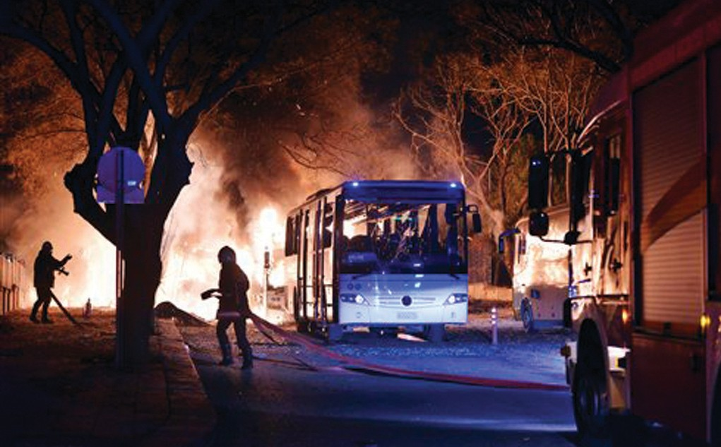 Firefighters work at a scene of fire from an explosion in Ankara Wednesday.