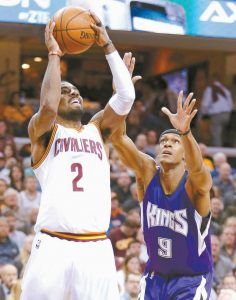 CLEVELAND'S Kyrie Irving (2) shoots over Sacramento Kings' Rajon Rondo (9) in the first half of an NBA basketball game on Monday in Cleveland.