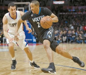 MINNESOTA TIMBERWOLVES guard Andre Miller, right, drives by Los Angeles Clippers guard Pablo Prigioni during the second half of an NBA basketball game on Wednesday in Los Angeles. The Timberwolves won, 108-102.
