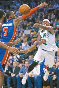 BOSTON CELTICS guard Isaiah Thomas, right, passes the ball as he is pressured by Detroit Pistons guard Kentavious Caldwell-Pope (5) during the first quarter of an NBA basketball game in Boston on Wednesday.