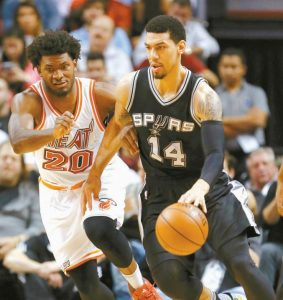 SAN ANTONIO guard Danny Green (14) drives past Miami Heat forward Justise Winslow (20) during the first half of an NBA basketball game on Tuesday.