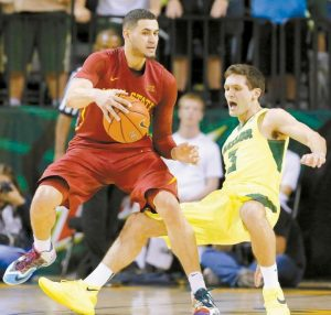 IOWA STATE'S Abdel Nader, left, knocks Baylor's Jake Lindsey (3) to the ground trying to position for a drive to the basket in the second half of an NCAA college basketball game on Tuesday in Waco, Texas. Baylor won in overtime, 100-91.