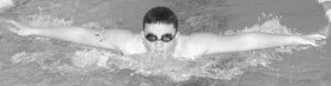 MORSE SWIMMER KEVIN MCCOY competes in the Boys 100-yard butterfly during the Kennebec Valley Athletic Conference Class B Swimming Championships at the Bath Area Family YMCA Tuesday. The Shipbuilder boys captured the KVAC title.
