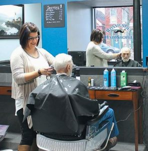 SHELBY ROSSIGNOL provides a haircut at the newly opened Rossignol's Hair Shoppe at 57 Maine St. in Brunswick.