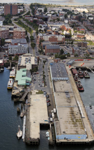 The 7-acre Maine State Pier includes the blue Portland Ocean Terminal building, seen from above at right. At upper left are the Casco Bay Lines ferry terminal and garage.