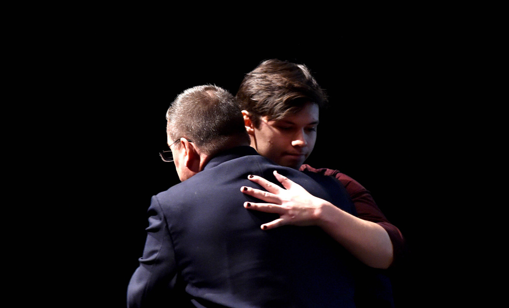 """Wayne Maines embraces his son, Jonas, after a presentation at the University of Maine at Farmington about tolerance and acceptance. Nicole Maines, Jonas' twin, is the subject of the book """"Becoming Nicole,"""" which chronicles the challenges she faced as a transgender youth in Orono."""