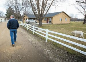 CLEVE CUSHING, executive director of Christian Children's Ranch, walks down a lane where homes and a school are provided for children and families in challenging situations. The ranch, located south of Eagle, Idaho, provides a rural lifestyle with horses, chickens and llamas that need tending and everyone pitches in to help.