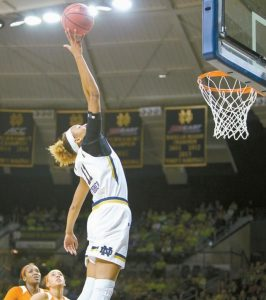 NOTRE DAME'S BRIANNA TURNER (11) jumps high for a tipped pass during the first half of an NCAA college basketball game against Clemson on Thursdayin South Bend, Ind.