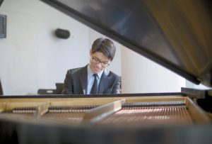 PIANIST JOON YOON performs a wide range of repertoire from Bach to Brahms to Carter.