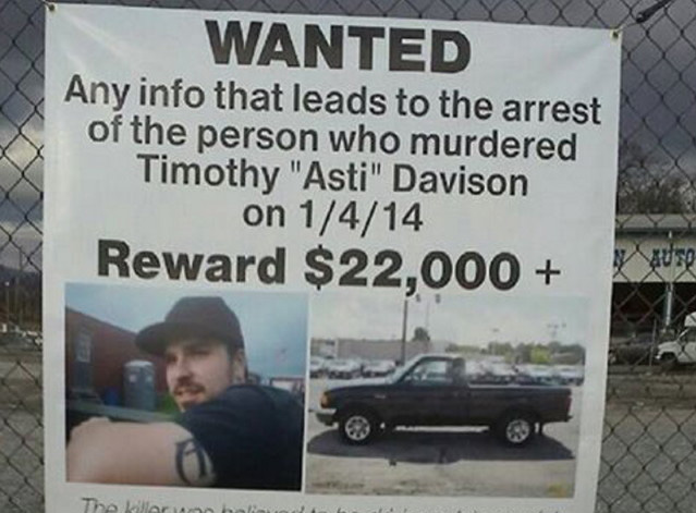 In this Jan. 6, 2015, photo,  a sign posted on a fence in Pennsylvania helped keep the death of Timothy 'Asti' Davison in the public eye.