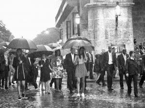 U.S. PRESIDENT BARACK OBAMA, center, with his first lady Michelle Obama, daughters Malia and Sasha and first lady's mother Marian Robinson, take a walking tour of Old Havana in the rain Sunday in Havana, Cuba. Obama became the first U.S. president to visit the island in nearly 90 years.