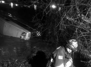 IN THIS IMAGE provided the Alameda County Fire Department, first responders work the scene after a car of a commuter train plunged into Alameda Creek after the train derailed Monday in Alameda County, California.