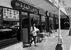 """A WOMAN wearing a traditional Muslim head covering exits a Lebanese eatery in Orange County's """"Little Arabia"""" neighborhood just miles from Disneyland.Orange County's """"Little Arabia"""" neighborhood in Anaheim, California, Wednesday. After Sen. Ted Cruz called for increased surveillance of Muslims in the U.S., this Muslim community and others like it defied the Republican presidential candidate and defended their commitment to the United States."""