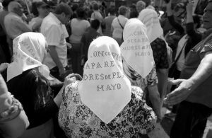MOTHERS OF PLAZA DE MAYO human rights group arrive at Plaza de Mayo do their traditional Thursday march in Buenos Aires, Argentina, today. The human rights group began marching there in 1977 to demand answers from the military junta on their missing relatives.