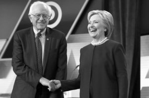 DEMOCRATIC presidential candidates, Hillary Clinton and Sen. Bernie Sanders, I-Vt, shake hands before the start of the Univision, Washington Post Democratic presidential debate at Miami-Dade College Wednesday in Miami, Florida.