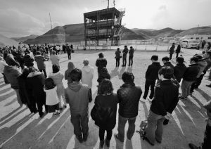 PEOPLE OBSERVE A MOMENT OF SILENCE at 2:46 p.m. for the victims of the 2011 earthquake and tsunami, in front of the skeletal remains of the former disaster prevention center in Minamisanriku, Miyagi prefecture, northern Japan Friday. Japanese gathered in Tokyo and along the country's ravaged northeast coast to observe a moment of silence exactly five years after a powerful earthquake struck offshore and triggered a devastating tsunami that killed more than 18,000 people.