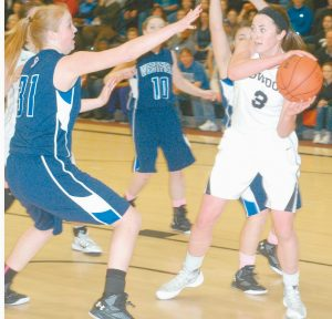 SHANNON BRADY of Bowdoin eyes a pass during an NCAA tournament game against Westerfield State recently. Kristen Swain defends for the Owls. Bowdoin won the contest at Morrell Gymnasium, 75-49, the first round.