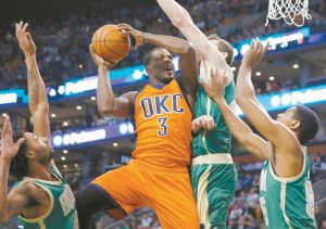 OKLAHOMA CITY'S Dion Waiters (3) shoots against Boston's Tyler Zeller, center right, during the fourth quarter of an NBA basketball game in Boston on Wednesday.