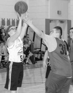 AMANDA MASON throws up a shot during a Unified basketball South Region Final on Tuesday. Lisbon hosts Hampden Academy tonight at 6 p.m. in the Unified Championship game.