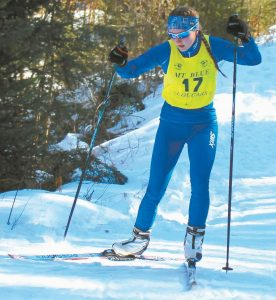 JENNY WILBRAHAM competes in the skate-style cross-country skiing event at the Maine Principals' Association Class A Nordic State Championships on Titcomb Mountain earlier this season.